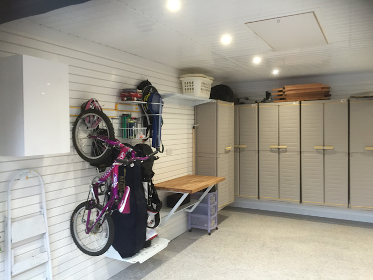 An Extraordinary Garage Makever with wall cabinets and bike storage Garageflex โรงรถและหลังคากันแดด White