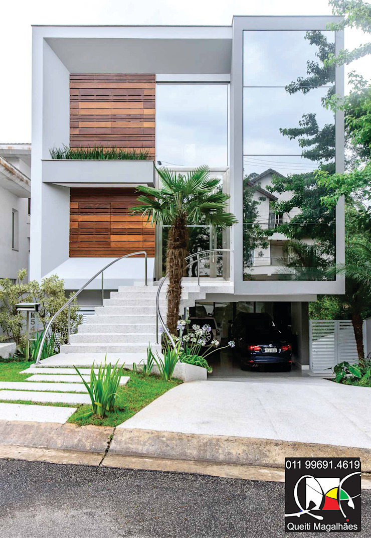 Fachada Casas modernas por Queiti Magalhães Arquitetura e Decorações Moderno
