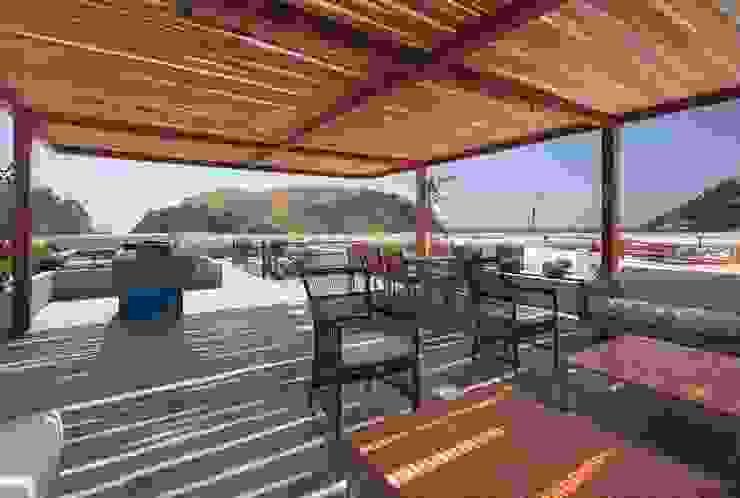 Casa Maple モダンデザインの テラス の Martin Dulanto モダン