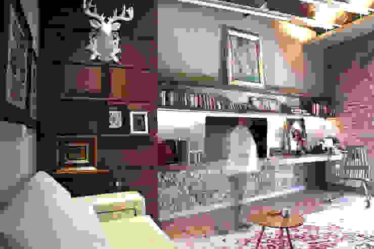 Salas de estar ecléticas por Brick Serveis d'Interiorisme S.L. Eclético