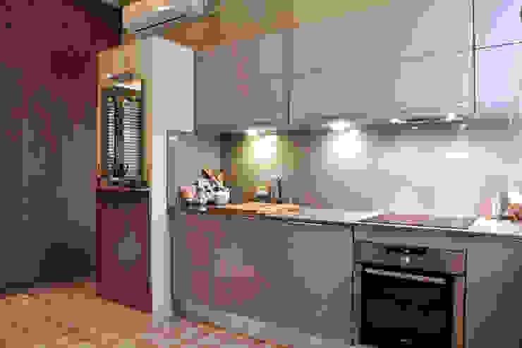 Cozinhas ecléticas por Brick Serveis d'Interiorisme S.L. Eclético