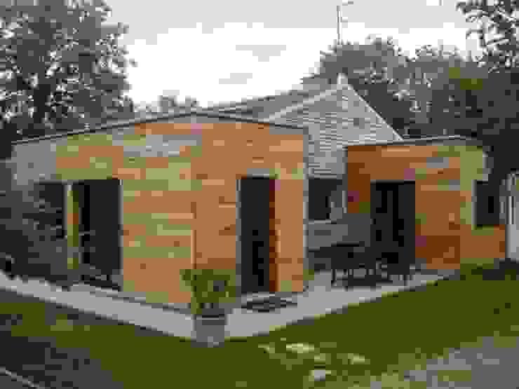Nouvelle entrée Maisons modernes par homify Moderne Bois Effet bois