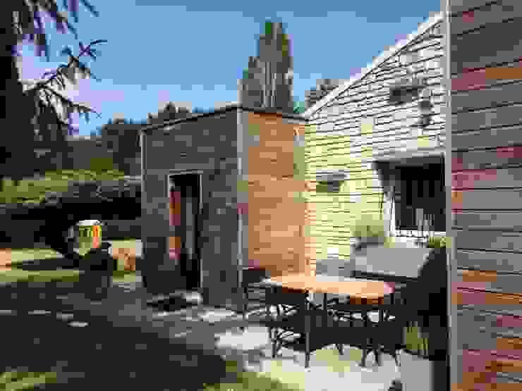 Terrasse extérieure Maisons modernes par homify Moderne Bois Effet bois