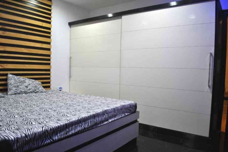 Vikas singh apartment Modern style bedroom by Arturo Interiors Modern
