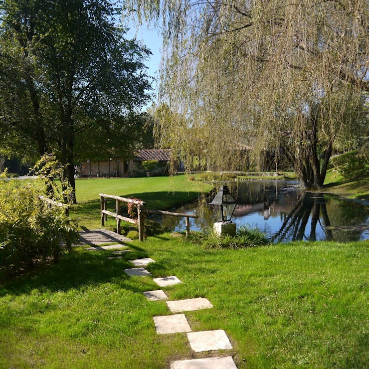Jardin rural par Studio arch. Claudio Palmi Caramel Rural