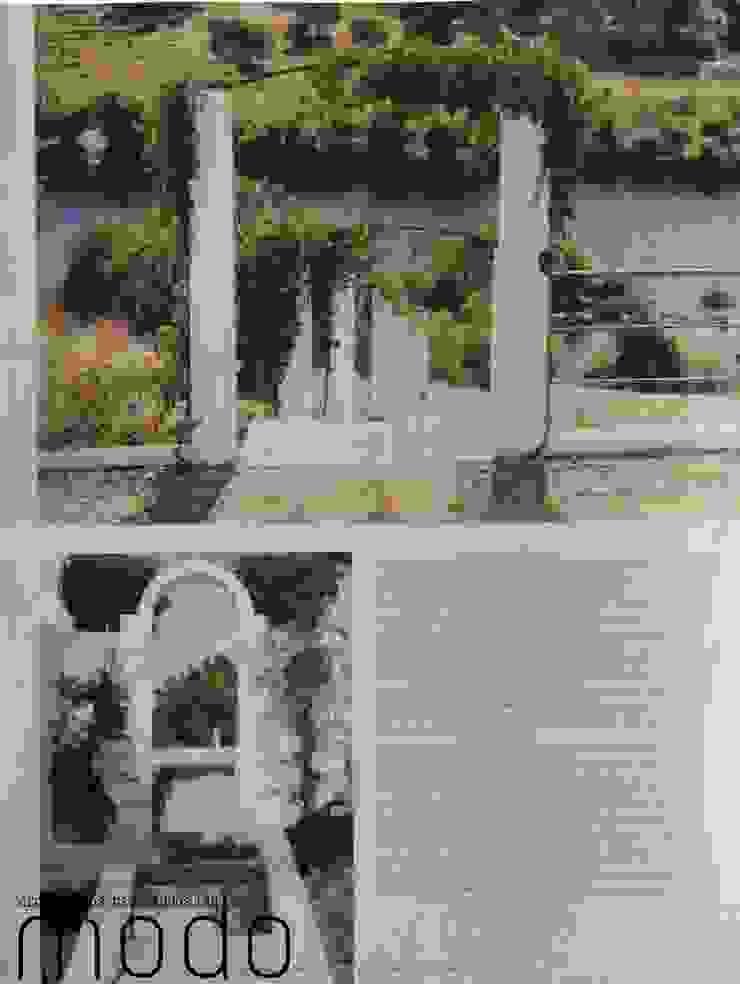 Reabilitação de moradia em Mouriscas Varandas, marquises e terraços rústicos por Modo Arquitectos Associados Rústico Pedra