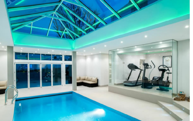 Pool areas closed in double glazing by Tech Glass and Aluminium Modern Glass