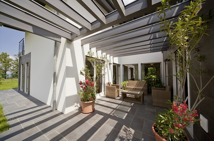 Jardines de invierno modernos de Spazio Positivo Moderno Metal