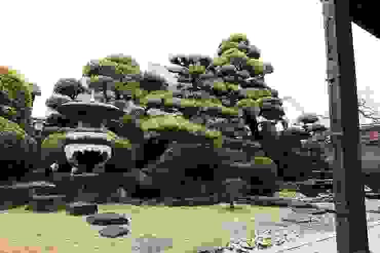 Jardins asiáticos por 杉田造園 株式会社 Asiático Pedra
