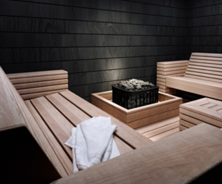Sauna de interior con bancos especiales y calefactor central modelo Saga Electro Spa modernos de Saunas Durán Moderno