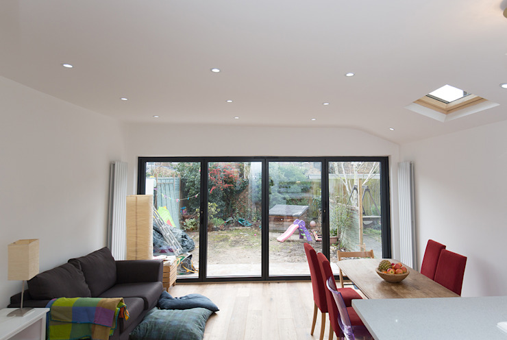 Big beautiful doors in your open plan space Modern dining room by The Market Design & Build Modern
