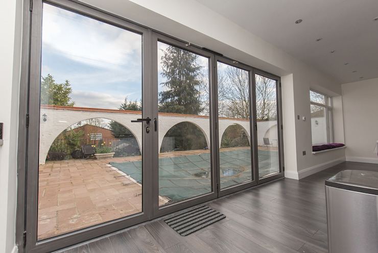 Doors leading out to the patio and pool Modern windows & doors by The Market Design & Build Modern