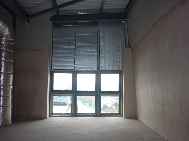 Before - office loft space showing low level windows от Design by UBER