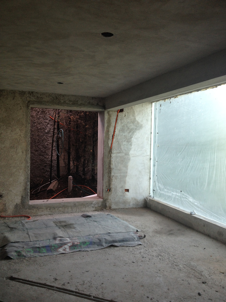 Estancias Salones eclécticos de Molcajete Arquitectura Interiores Diseño Ecléctico