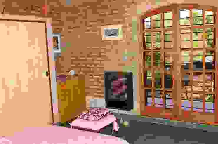 Liliana almada Propiedades Rustic style bedroom