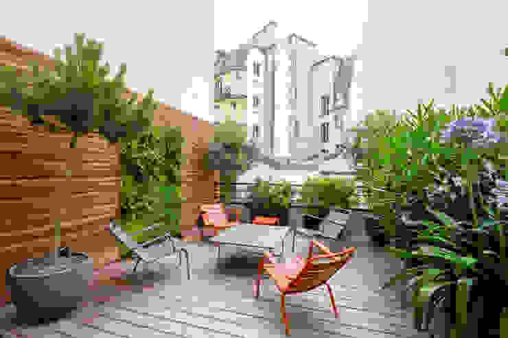 Patios & Decks by Terrasses des Oliviers - Paysagiste Paris, Modern
