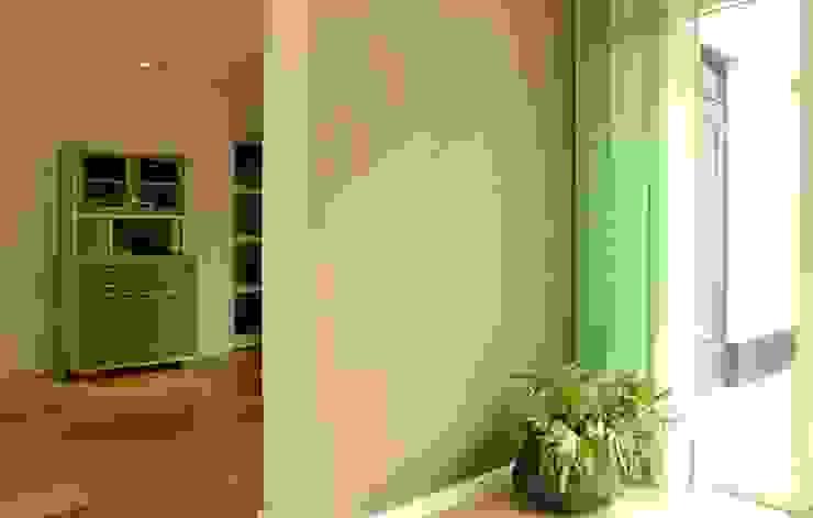 Paredes y pisos de estilo moderno de Atelier09 Moderno