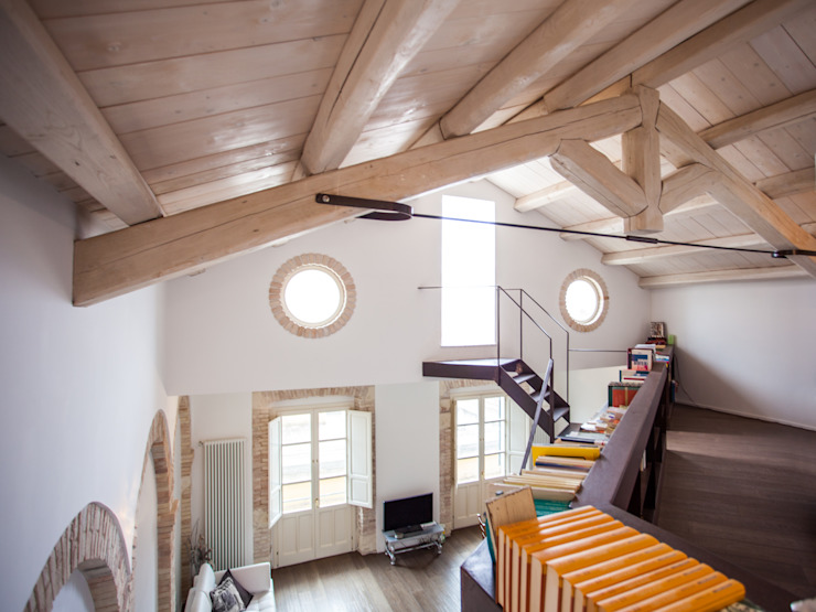 Salas de estar modernas por STUDIO DOTT. ARCH. GIANLUCA PIGNATARO Moderno Madeira Acabamento em madeira