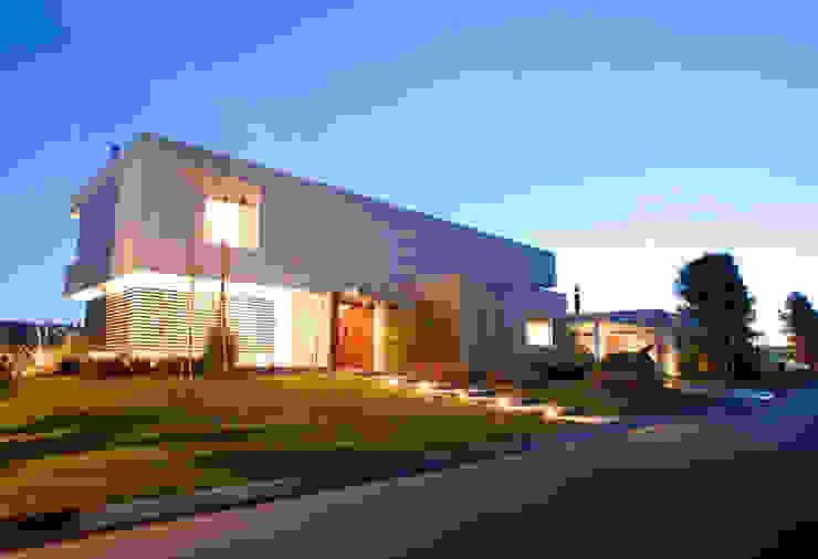 Casas de estilo  por Poggi Schmit Arquitectura, Moderno