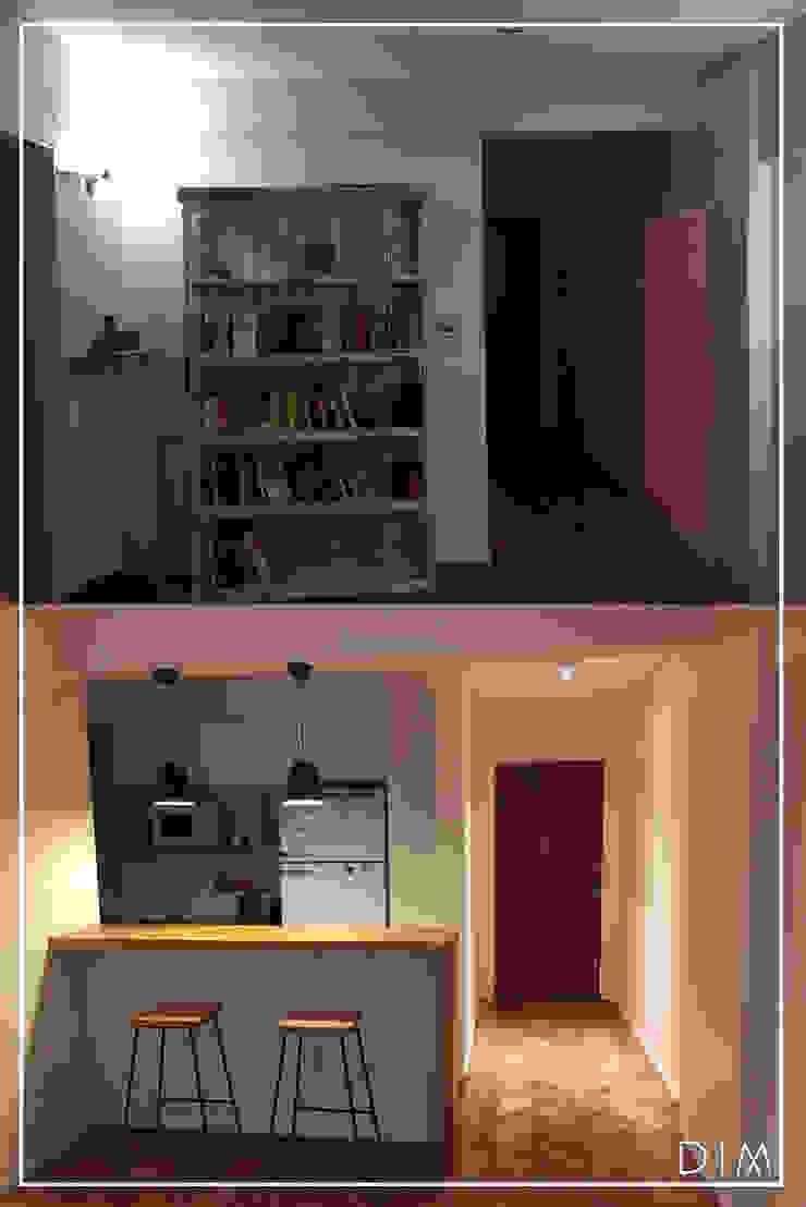Столовая комната в стиле минимализм от DIM Arquitectura Минимализм Дерево Эффект древесины