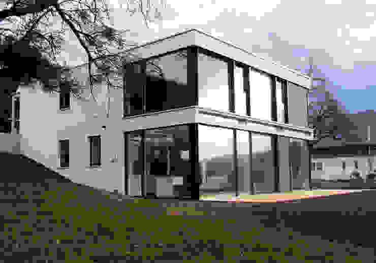 Дома в стиле модерн от mmarch gmbh - Mader Marti Architektur ETH SIA Модерн Стекло