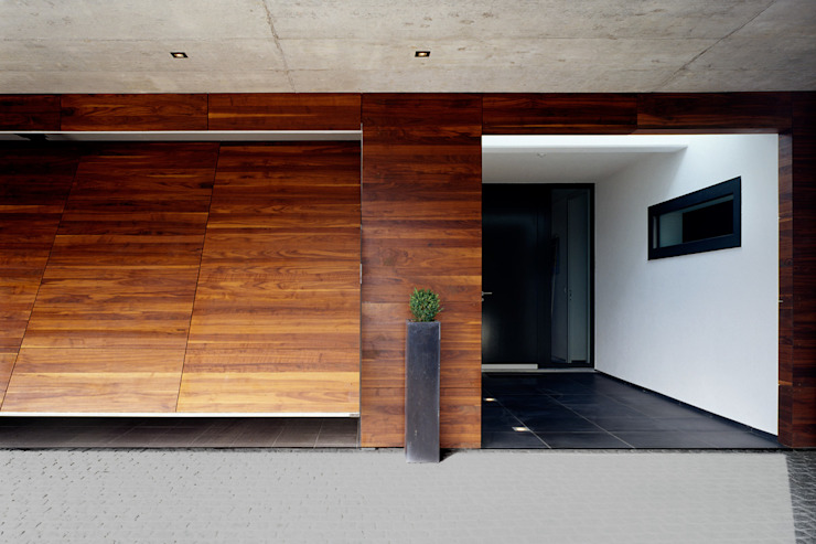 homify Moderne Garagen & Schuppen