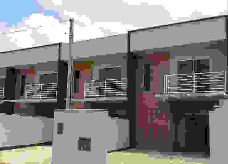 Casas estilo moderno: ideas, arquitectura e imágenes de mga.arq Moderno Ladrillos