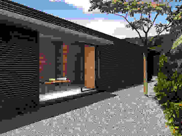 Casa Estadía - RIMA Arquitectura Balcones y terrazas modernos de RIMA Arquitectura Moderno