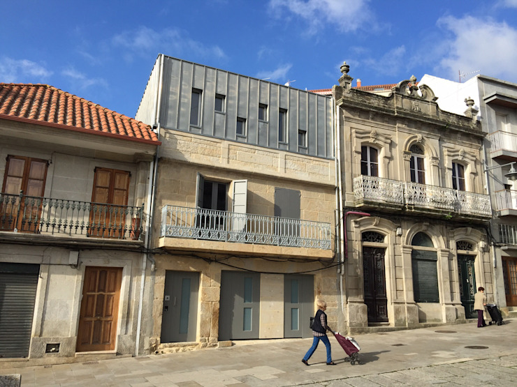 Rehabilitación de vivienda Unifamiliar. Casas de estilo moderno de HUGA ARQUITECTOS Moderno Piedra
