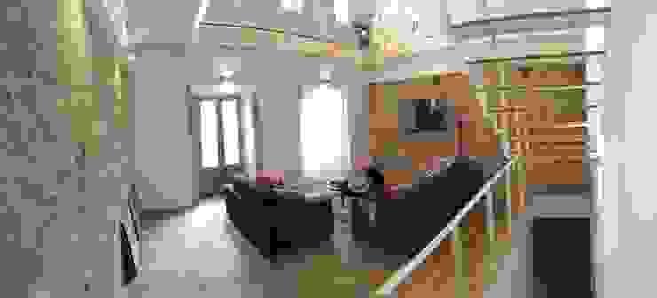 Rehabilitación de vivienda Unifamiliar. Salones de estilo moderno de HUGA ARQUITECTOS Moderno Piedra