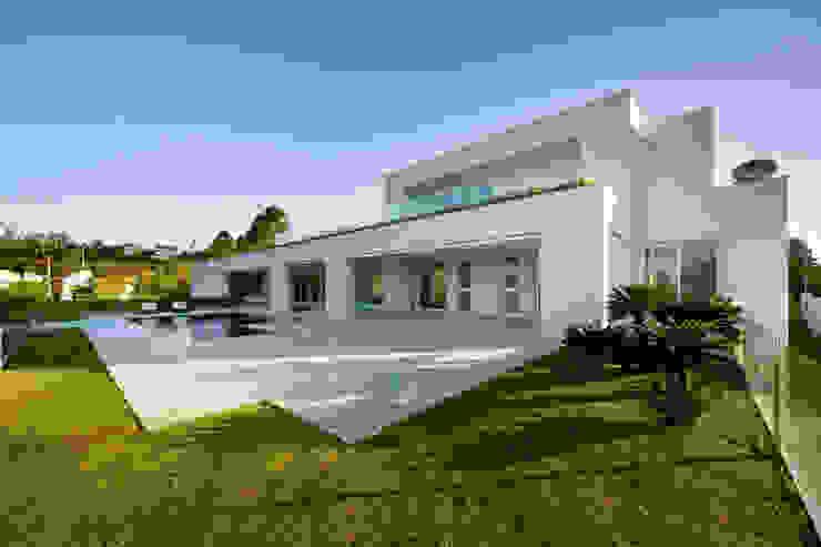 Casa no Morro do Chapéu: Casas  por Lanza Arquitetos,Moderno