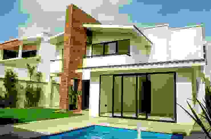 Fachada trasera Casas modernas de ARKOT arquitectura + construcción Moderno