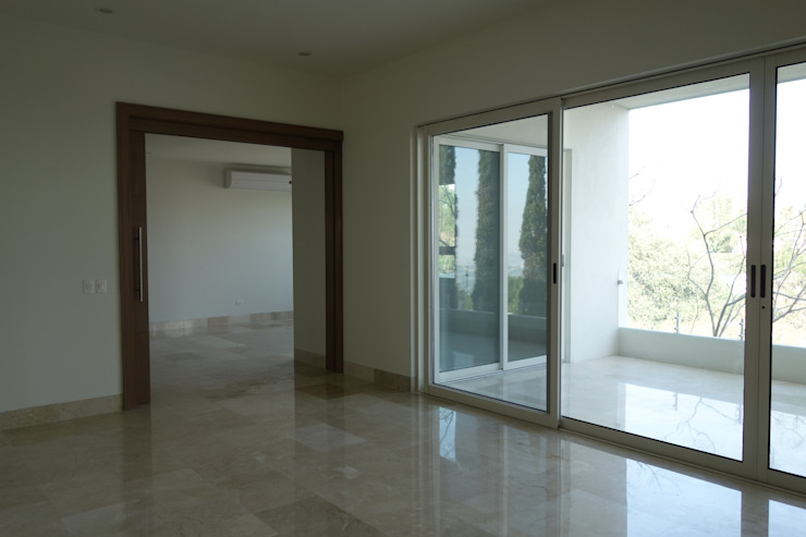 Residencias LV Salones modernos de CH Proyectos Moderno