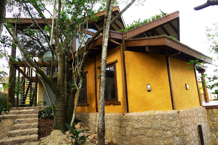 Rustic style houses by Baixo Impacto Arquitetura Ltda. Rustic