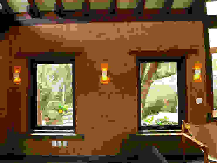 Paredes e pisos rústicos por Baixo Impacto Arquitetura Ltda. Rústico