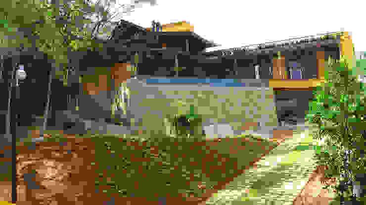 Casas rústicas por Baixo Impacto Arquitetura Ltda. Rústico