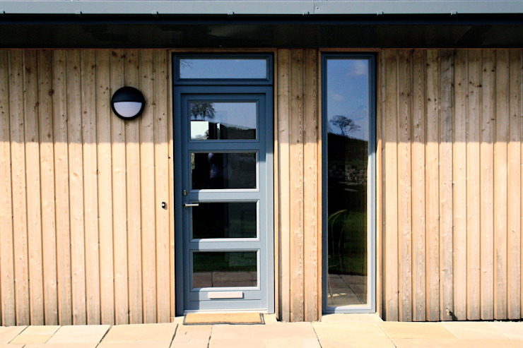 Timber clad entrance extension de Fife Architects