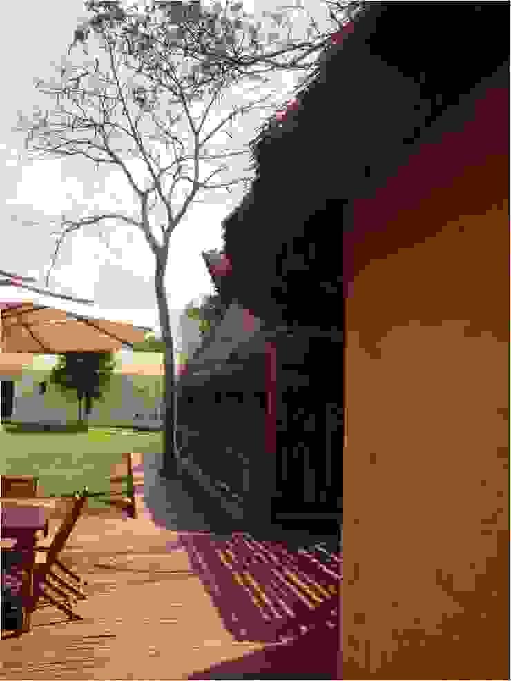 VISTA LATERAL EN PALAPAS ZODZIL Casas clásicas de AIDA TRACONIS ARQUITECTOS EN MERIDA YUCATAN MEXICO Clásico Concreto