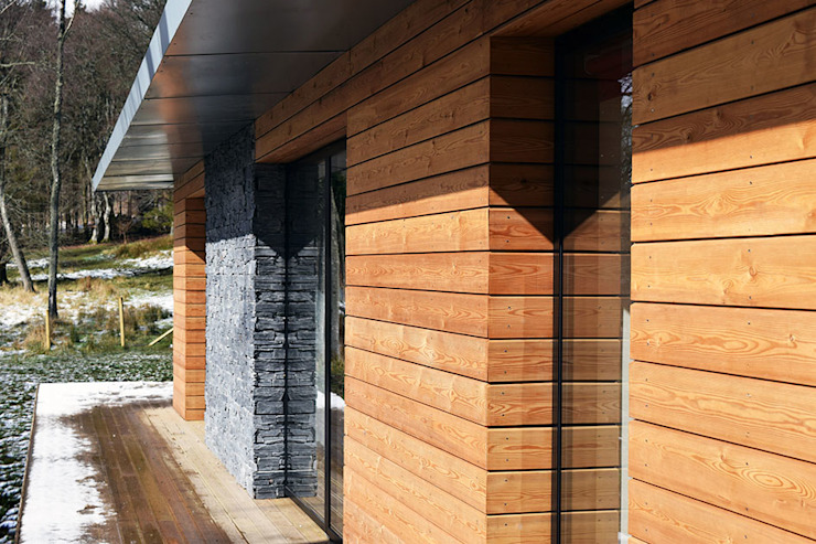 Detail of timber and stone cladding Brown + Brown Architects Modern houses Wood