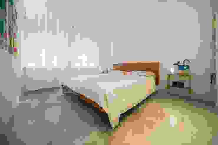 Camera da letto PADIGLIONE B Camera da letto minimalista Cemento
