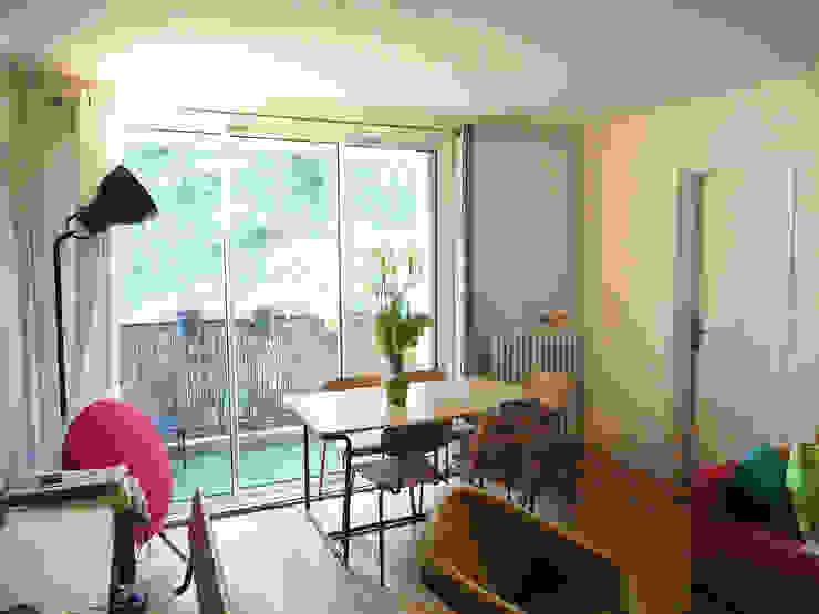 Minimalist dining room by Agence 1+1 Minimalist
