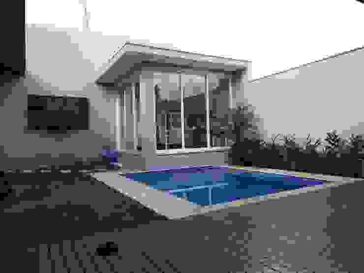 Gimnasios domésticos de estilo  por Lozí - Projeto e Obra, Moderno