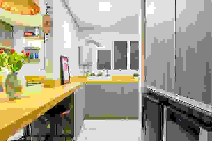 Área de Serviço Integrada com Cozinha Cozinhas ecléticas por Motirõ Arquitetos Eclético