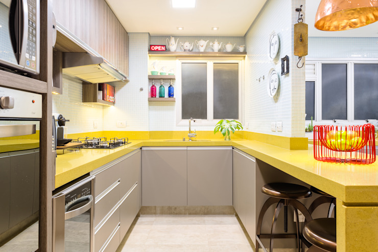 Eclectic style kitchen by Motirõ Arquitetos Eclectic Granite