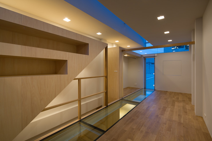 Quartos modernos por 藤原・室 建築設計事務所 Moderno