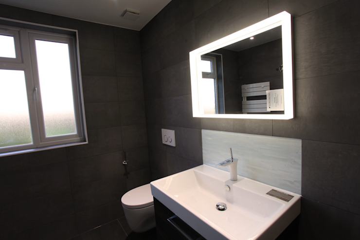 We love the light around this mirror!:  Bathroom by The Market Design & Build, Modern