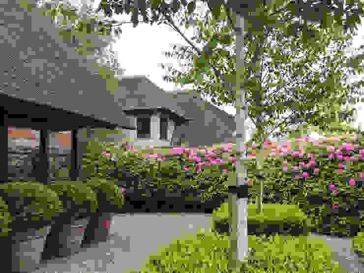 Jardines de estilo  por Vosselman Buiten,