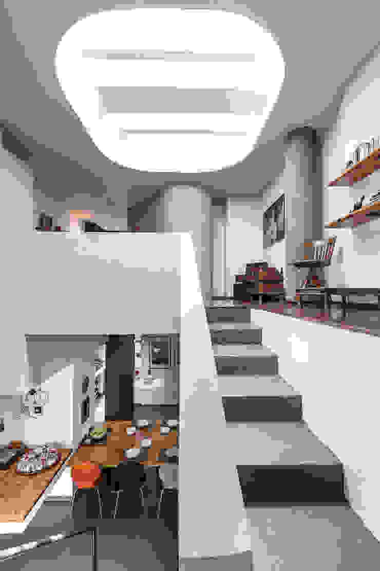 Modern corridor, hallway & stairs by Architrek Modern