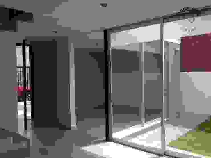 Casa Alborada Salones minimalistas de La Maquiladora / taller de ideas Minimalista