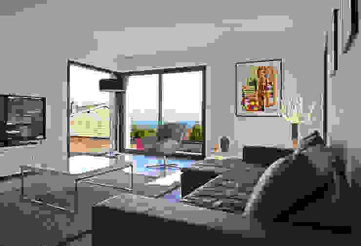 Salon avec baies vitrées Salon moderne par Pierre Bernard Création Moderne